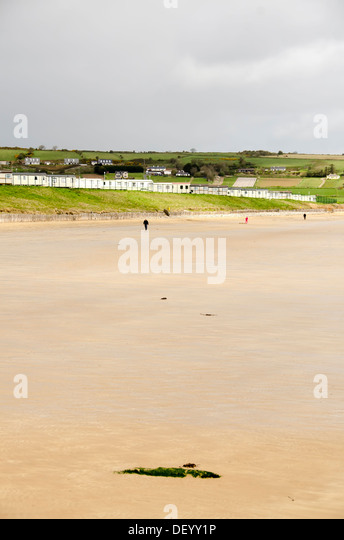 Low tide beach at Ardmore, a popular  seaside resort and fishing village in County Waterford, Ireland - Stock Image