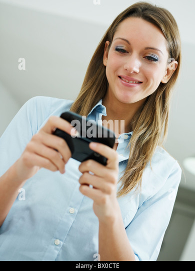 woman reading emails on mobile phone. Copy space - Stock Image