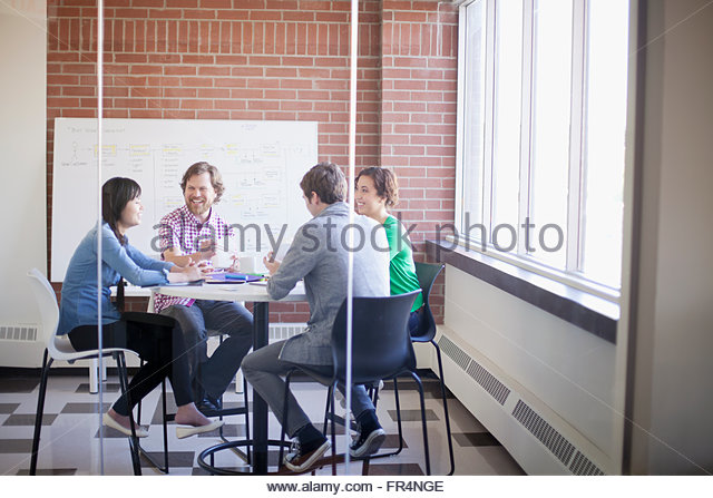 young creatives having lunch and conversation - Stock Image