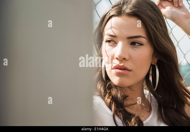 Young brunette woman wearing earrings - Stock-Bilder