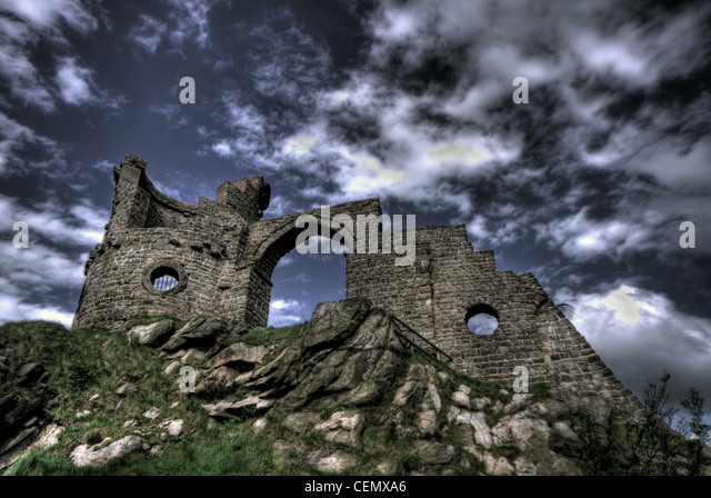Mow Cop Folly stone rock Macclesfield Congleton Cheshire England UK NT National Trust looking up at monument, with - Stock Image