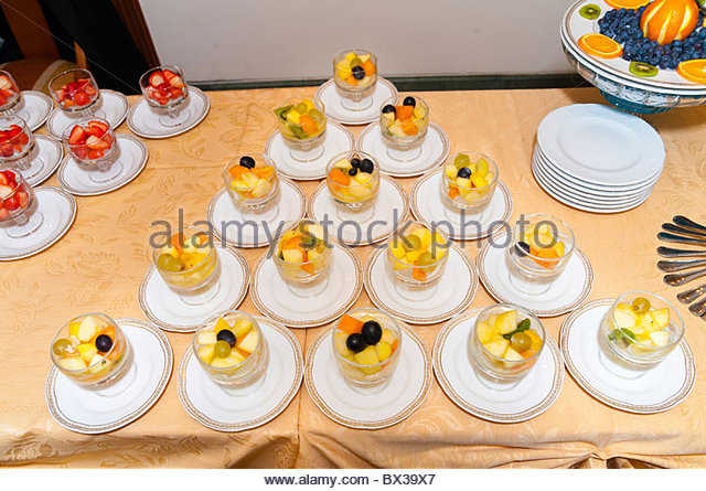 A mixture of fruits served in a triangle shape - Stock Image