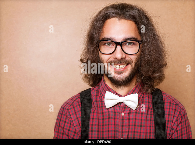Hipster guy 's clothes in plaid shirt , suspenders and white butterfly . Close up. Studio shot - Stock-Bilder