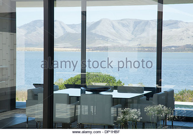View of lake from window of modern house - Stock Image