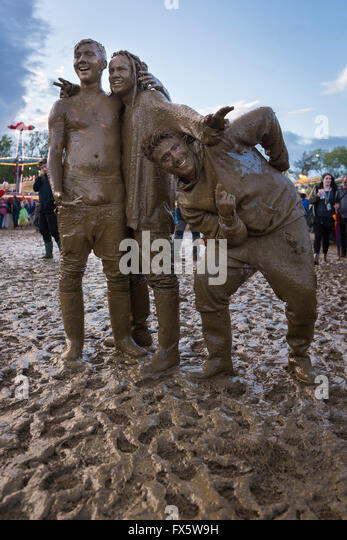 Friends mud wrestling at the 2015 womad festival malmesbury uk