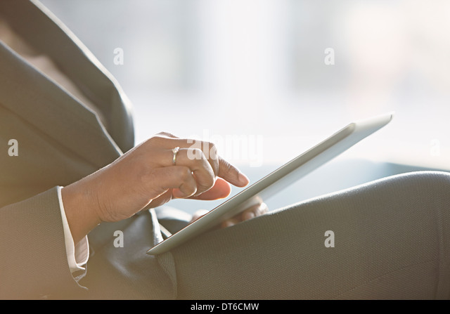 Businesswoman using digital tablet, close up - Stock Image