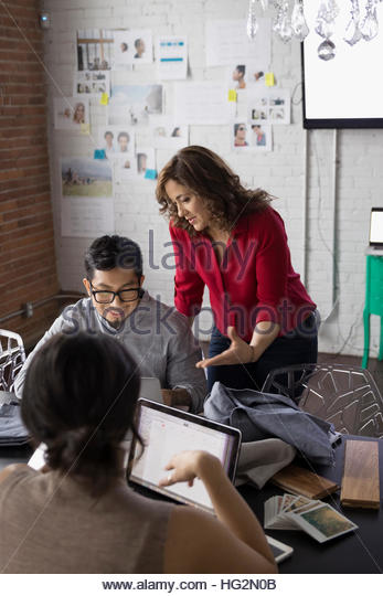 Hispanic designers meeting in conference room - Stock Image