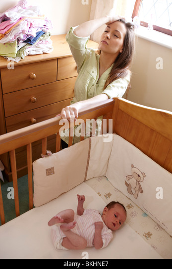 Woman alone with baby - Stock Image