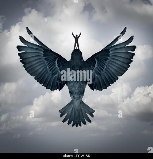 Success freedom business concept as a man riding an open wing bird flying upward as a symbol for reaching career - Stock-Bilder