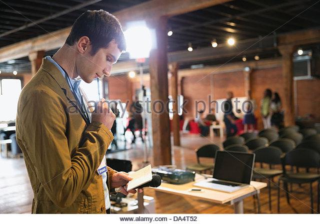 Entrepreneur preparing for presentation in conference room - Stock-Bilder
