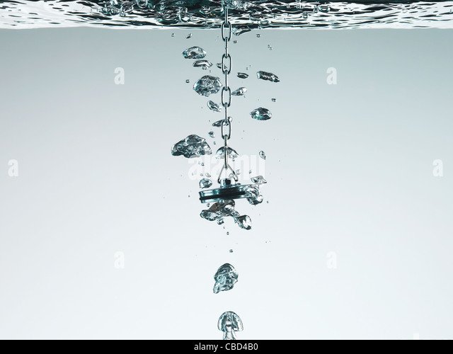 Plug bubbling in water - Stock Image