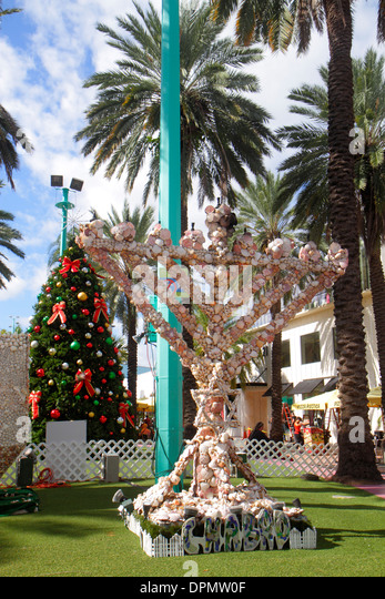 Miami Beach Florida Lincoln Road Mall Christmas tree menorah Hanukkah lamp Jewish traditions - Stock Image