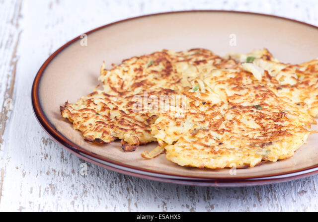 parsnip pancakes on the plate - Stock Image