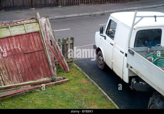 Builders Pick Up Van with Broken Garden Fencing - Stock Image