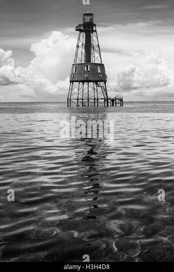 The oldest of Florida's 6 reef lights, Carysfort Light sits in shimmering shallows 7 miles off Key Largo, Florida. - Stock Image