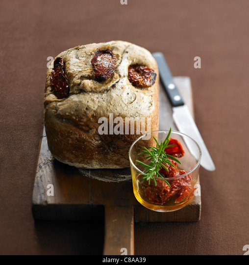 Dried tomato and Provence herb bread loaf - Stock Image
