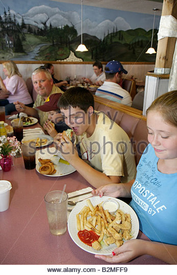 Indiana Kouts Joy's Family Restaurant comfort food man boy girl family meal eat hungry fries chicken strips - Stock Image