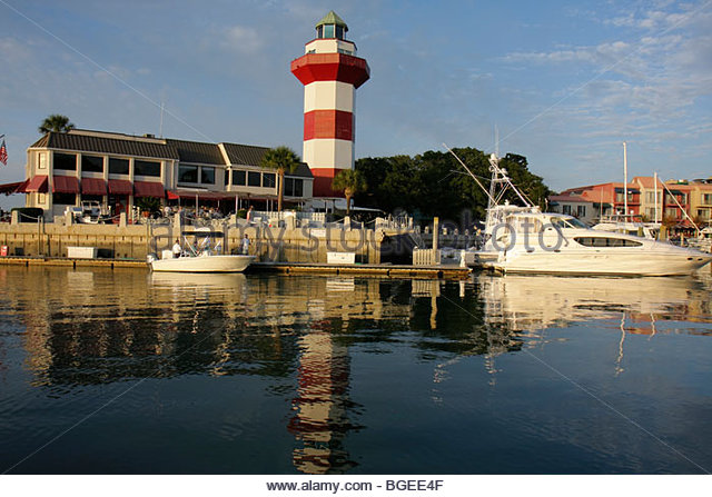 South Carolina Hilton Head Island Sea Pines Plantation South Beach Harbour Town resort lighthouse red white striped - Stock Image