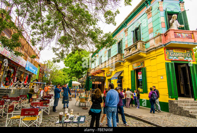 Buenos Aires Argentina La Boca colorful streets and buildings with tourists on corner with shops and restaurants - Stock Image