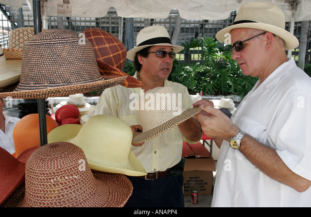 Hialeah Florida Hispanic Heritage Month Celebration festival Panama hats made in Ecuador man shops vendor - Stock Image