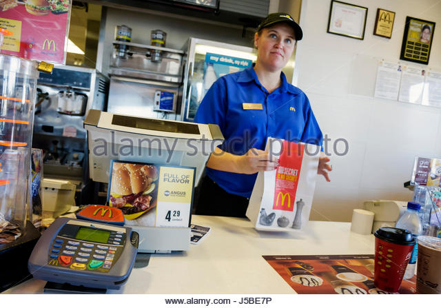 Georgia South Newport McDonald's Restaurant chain franchise dining fast food name brand counter woman cashier - Stock Image