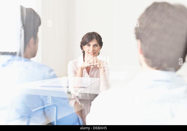 Business people viewed through window - Stock Image