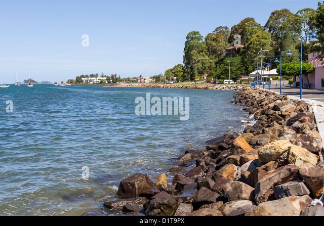 Manmade rocky foreshore at Batemans Bay, NSW Australia as an erosion control mechanism - Stock Image