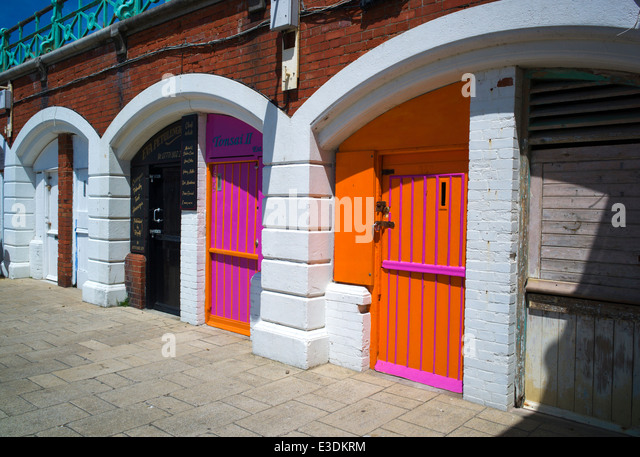 Colourful arches beneath King's Road, near the pier, Brighton, Sussex, UK - Stock Image