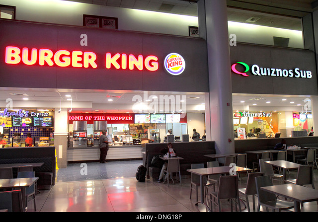 Charlotte North Carolina Charlotte Douglas International Airport CLT terminal concourse gate area fast food restaurant - Stock Image