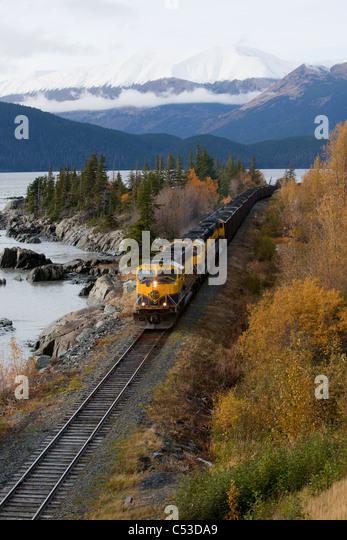 Alaska Railroad hauls coal past Rocky Cove at Bird Point along Turnagain Arm, Southcentral Alaska, Autumn - Stock-Bilder