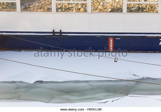Ice at the side of some boad - Stock Image