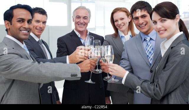 Cheerful international business people celebrating a sucess - Stock-Bilder