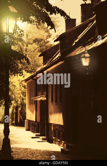 atmospheric, moody street with lanterns - Stock Image