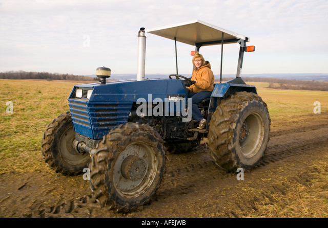 Woman Driving Tractor Stock Photos & Woman Driving Tractor ...