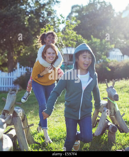 Students and teacher walking outdoors - Stock Image
