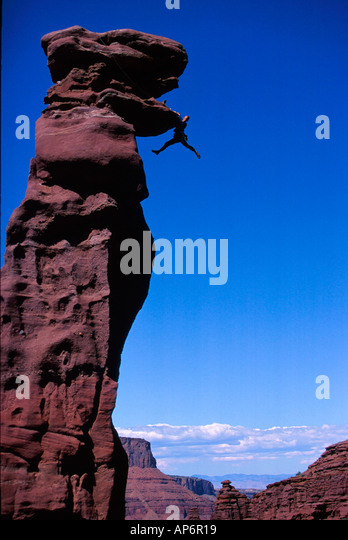 Rock climber in difficulty on overhang in Fisher Towers, Colorado River Waterway near Castle Valley in Moab, Utah, - Stock Image
