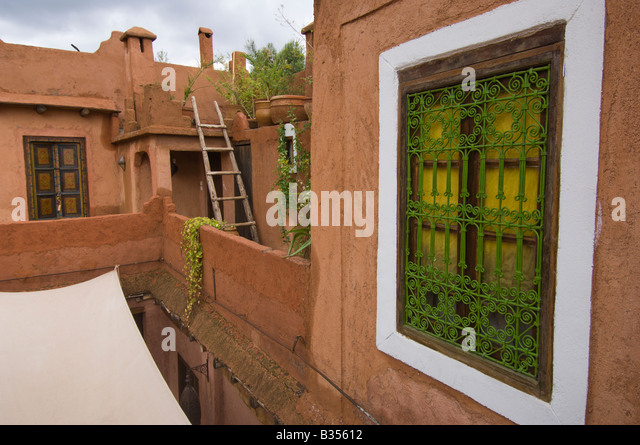 Screened window in a Ryad, traditional Berber building made of clay, Atlas mountains, Morocco - Stock Image