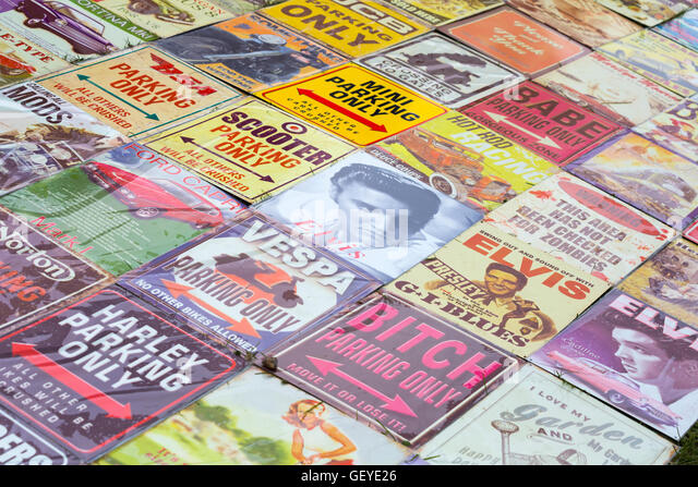 Nostalgic metal tin posters on display on stall at New Forest & Hampshire County Show, Brockenhurst in July - Stock-Bilder