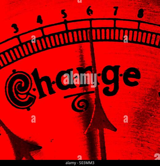 Red barometer with needle pointing to change - Stock Image