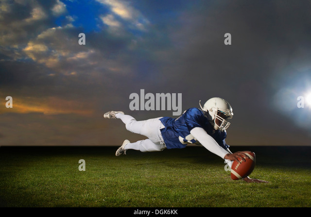 American football player reaching for touch down - Stock-Bilder