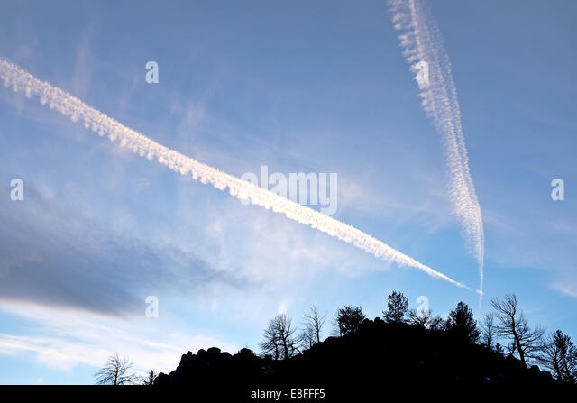 Contrails in sky - Stock Image