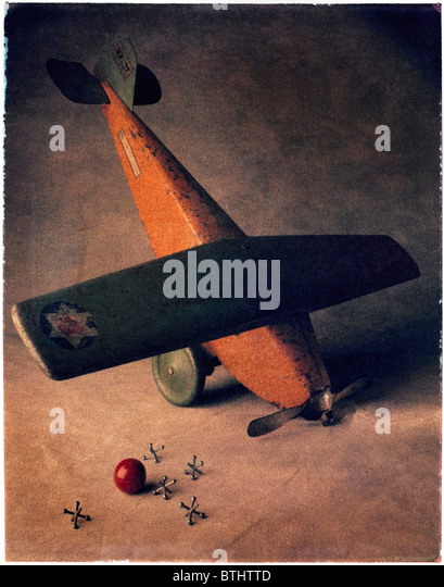 toy airplane with red ball and jacks. - Stock Image