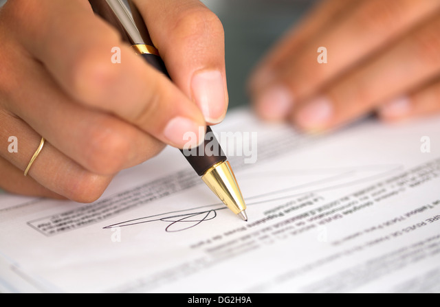 Businesswoman female fingers hands paper pen - Stock Image
