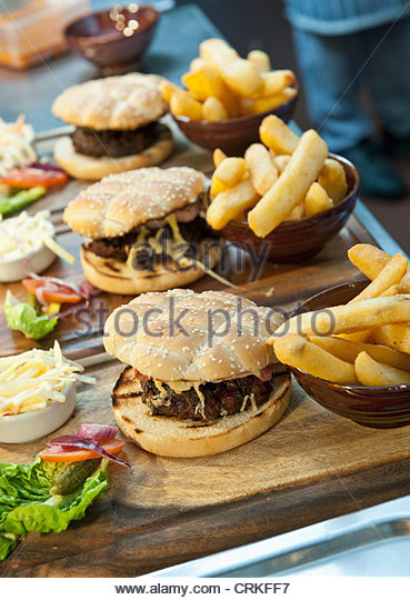 Plates of burgers and french fries - Stock-Bilder