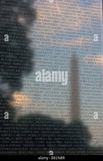 Vietnam War Memorial, Washington D.C. Washington Monument reflected on black granite, soldier names reflect in sky, - Stock Image