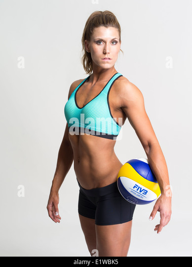 Muscular toned athletic woman - beach volleyball player - Stock Image