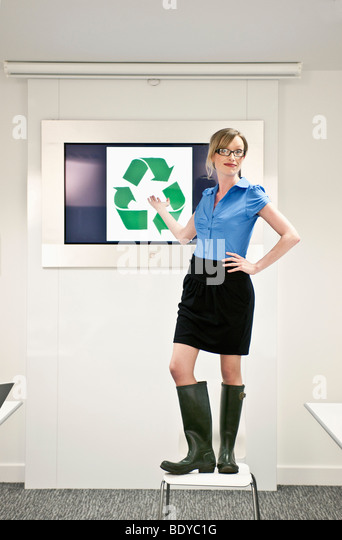woman presenting green concepts - Stock Image