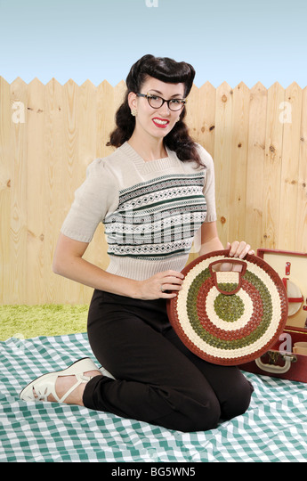 Woman in vintage clothing holding a bag - Stock Image