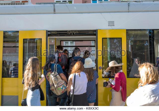 Portugal Lisbon Carris Tram 15 trolley Belem route public transportation boarding man woman passengers - Stock Image