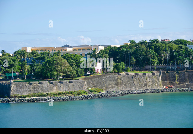 Puerto Rico Old San Juan old city wall as seen from channel entrance - Stock Image